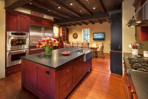 The expansive kitchen is warm and wonderful gathering area.