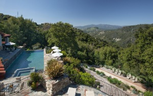 The infinity pool overlooks the Santa Ynez Valley and Deer Lodge's Bocce Ball Court.