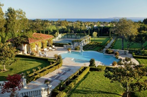 Manicured gardens surround the pool pavilion and tennis court of this Montecito estate.