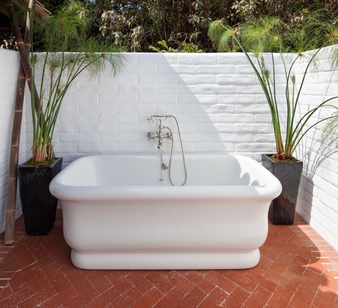 A quiet location allows for relaxing soaks in the master bath's outdoor tub.