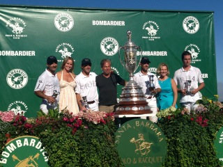 Riskin Associate Sarah Kelly presents the trophy to Team Restoration Hardware