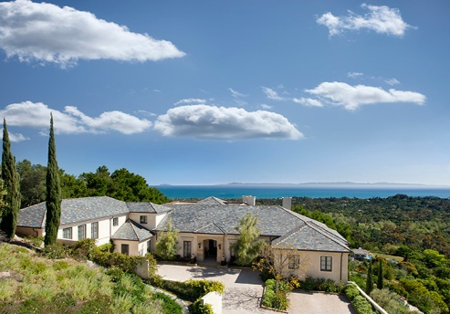 The unique hilltop location affords the home incredible ocean and Island views.