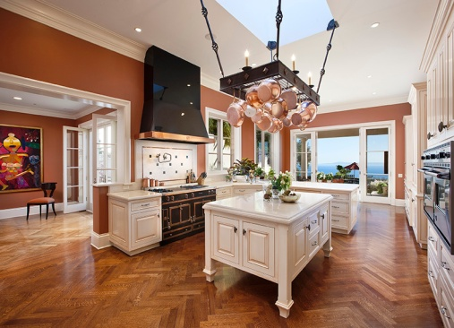 Brilliant ocean view and luxurious La Cornue range are unique and coveted features of this kitchen.