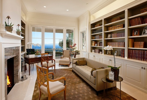 The Montecito residence's library overlooks the ocean through French doors opening to a quiet patio.