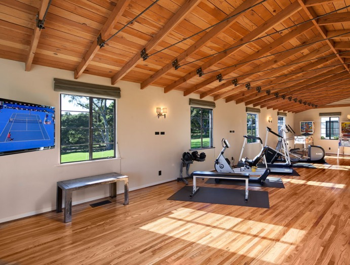 A guest apartment features a gym, full kitchen and bedroom with full bath.