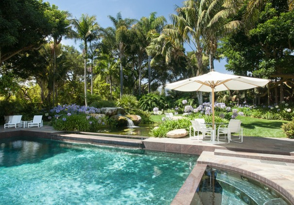 lush tropical grounds surround a pristine ocean view estate in Santa Barbara