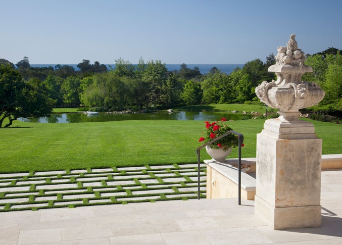 Serene ocean views are an idyllic backdrop to gardens and lawns.